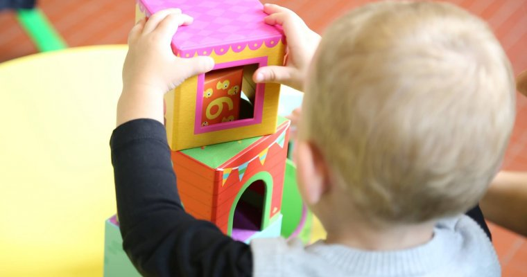 Nursery child building with toys - you can pay for nursery with tax free childcare