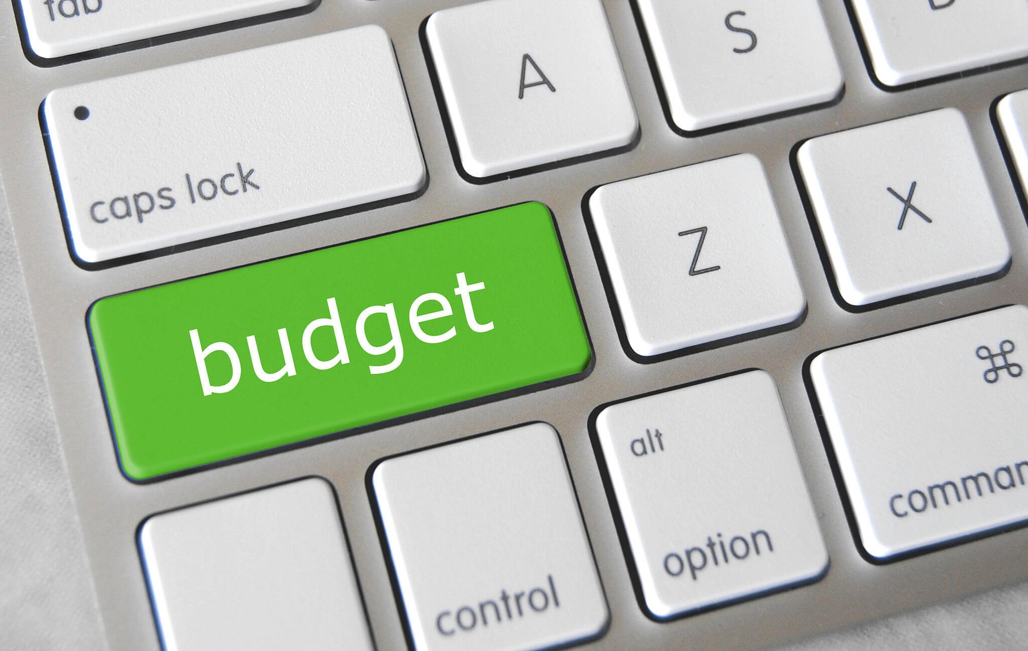 Green budget key on a keyboard