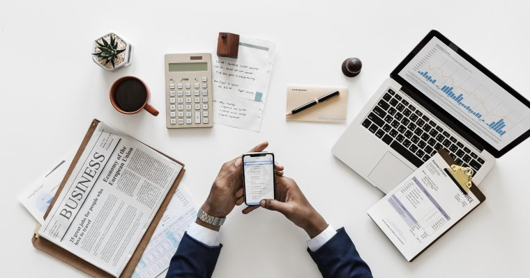 is investing for everyone? Man has lots of devices to help with investing - paper, phone and computer